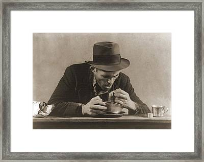 Hungry Man With His Meal Of Bread Framed Print by Everett