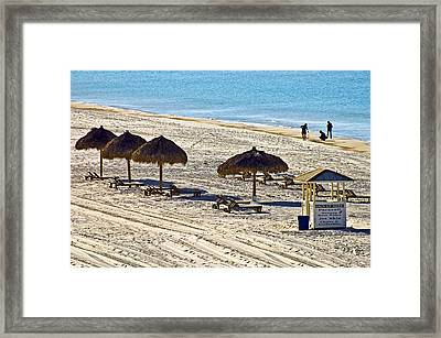 Huts On The Beach Framed Print by Susan Leggett
