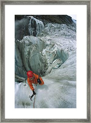 Ice Climber On Steep Ice In Fox Glacier Framed Print by Colin Monteath