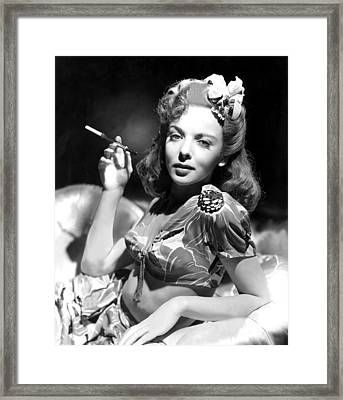 Ida Lupino, Portrait Of Her Smoking Framed Print by Everett