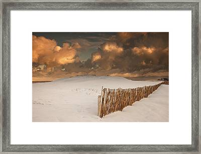 Illuminated Clouds Glowing Over A Snow Framed Print by John Short