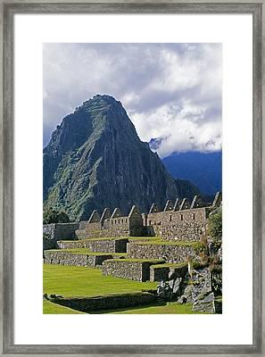 Inca Structures Stand Below Mount Framed Print by Gordon Wiltsie