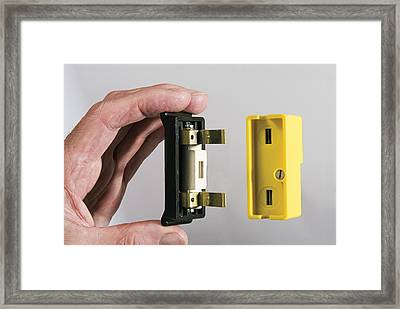 Inserting A 20 Amp Fuse Framed Print by Sheila Terry