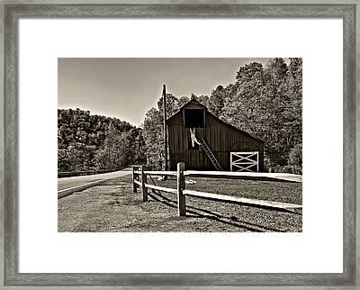 Involved In One's Work Sepia Framed Print by Steve Harrington
