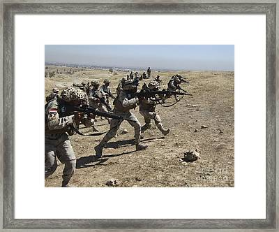 Iraqi Army Soldiers Move To Positions Framed Print by Stocktrek Images