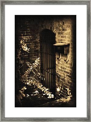 Iron Door Sepia Framed Print by Kelly Hazel
