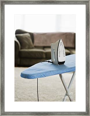 Iron On An Ironing Board Framed Print by Ben Sandall