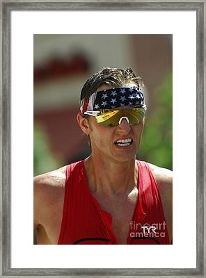 Ironman On The Run Framed Print by Bob Christopher