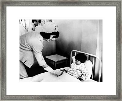 Jacqueline Kennedy Left, Presents Framed Print by Everett