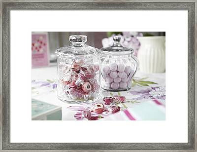 Jars Of Candies On Table Framed Print by Debby Lewis-Harrison