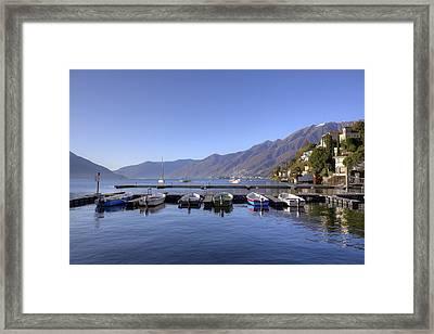 jetty in Ascona Framed Print by Joana Kruse