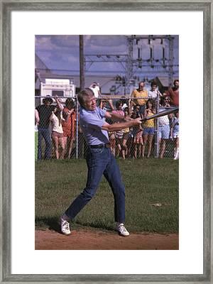Jimmy Carter At Bat During A Softball Framed Print by Everett