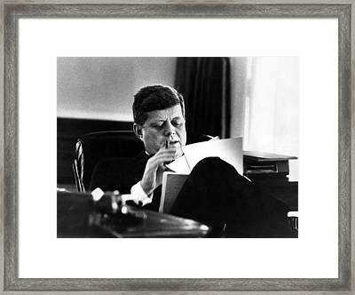 John F. Kennedy, In His Office Framed Print by Everett