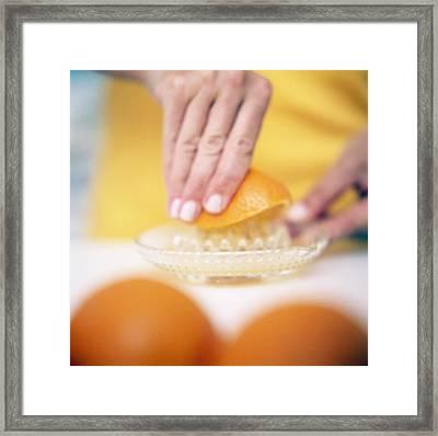Juicing Oranges Framed Print by Cristina Pedrazzini