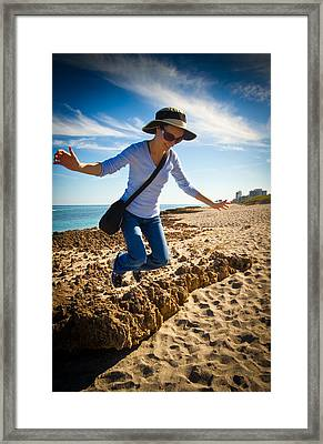 Jumping For Joy Framed Print by Andres Leon