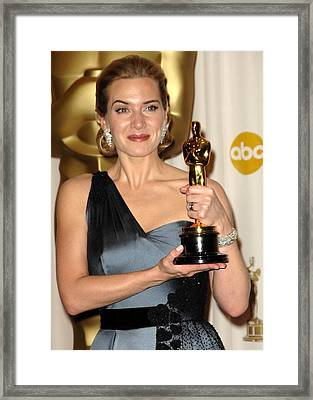 Kate Winslet Wearing An Yves Saint Framed Print by Everett