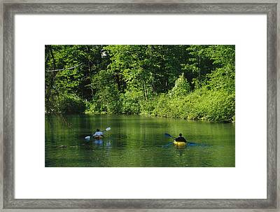 Kayakers Paddle In The Headwaters Framed Print by Raymond Gehman