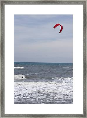 Kiteboarder With Kite In The Waves Framed Print by Skip Brown