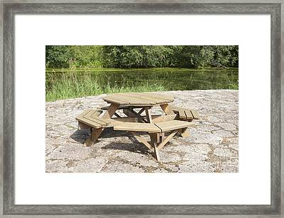 Lakeside Picnic Table Framed Print by Jaak Nilson