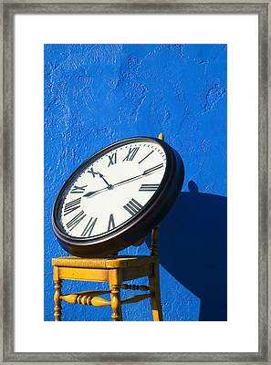 Large Clock On Yellow Chair Framed Print by Garry Gay