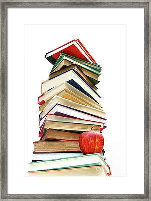 Large Pile Of Books Isolated On White Framed Print by Sandra Cunningham