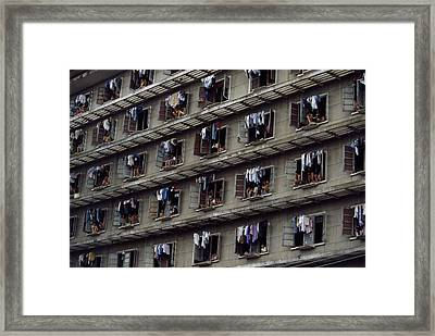 Laundry Drying Outside Apartments Framed Print by Paul Chesley