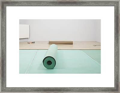 Laying A Floor. A Roll Of Underlay Or Framed Print by Magomed Magomedagaev
