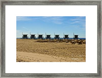 Lifeguard Stand's On The Beach Framed Print by Micah May