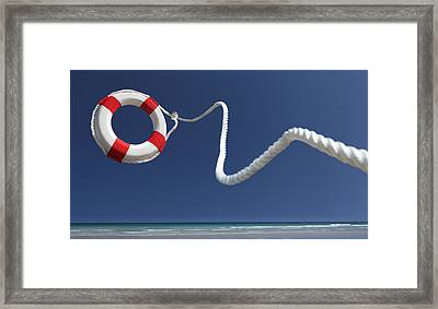 Lifering In Air On Beach Framed Print by Peter Cade