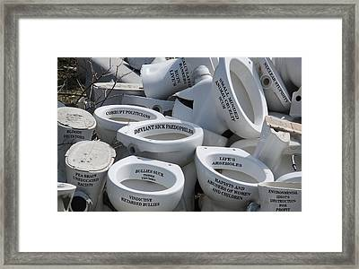 Lifes Arseholes Framed Print by Eric Kempson