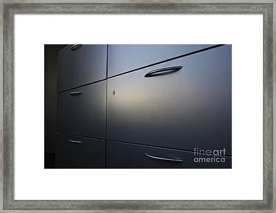 Light Shining On Metal Drawers Framed Print by Jetta Productions, Inc