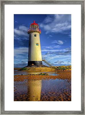 Lighthouse Framed Print by Adrian Evans