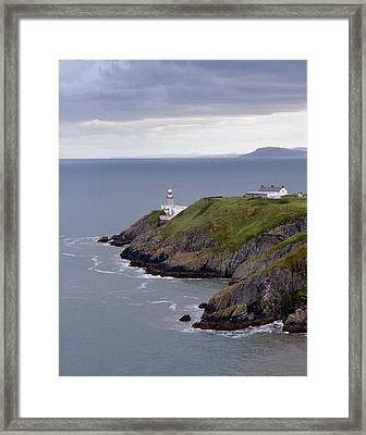Lighthouse And Sea Framed Print by Marcio Faustino
