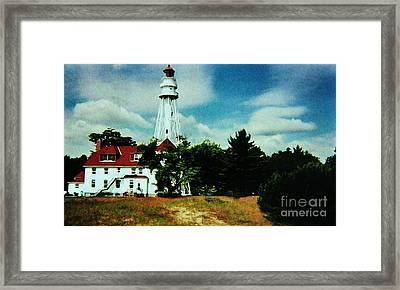 Lighthouse Off Lake Michigan Framed Print by Marsha Heiken
