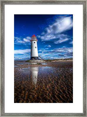 Lighthouse Reflections Framed Print by Adrian Evans