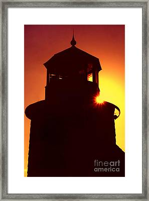 Lighthouse Sunset Framed Print by Joann Vitali