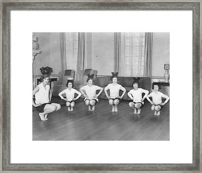Line Of Girls (7-12) Exercising With Bowls On Heads (b&w) Framed Print by Hulton Archive