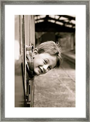 Little Boy Leaning Out Of A Train Window Framed Print by Tom Gowanlock