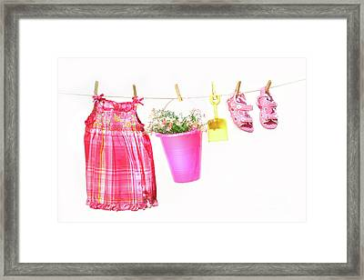 Little Girl Clothes And Toys On A Clothesline Framed Print by Sandra Cunningham
