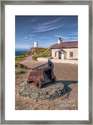 Llanddwyn Cannon Framed Print by Adrian Evans