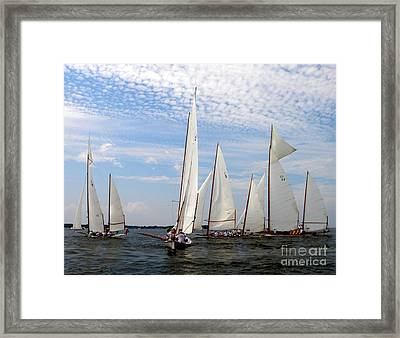 Log Canoes Framed Print by Lainie Wrightson