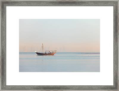 Lone Dhow In Qatar Framed Print by Paul Cowan