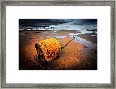 Lonely Yellow Buoy Framed Print by Meirion Matthias