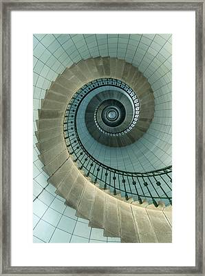 Looking Up The Spiral Staircase Of The Framed Print by Axiom Photographic
