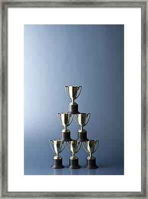 Loving Cup Trophies Stacked In A Pyramid Framed Print by Larry Washburn