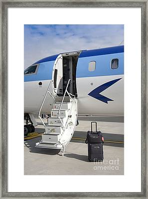 Luggage Near Airplane Steps Framed Print by Jaak Nilson