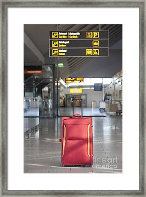 Luggage Sitting Alone In An Airport Terminal Framed Print by Jaak Nilson