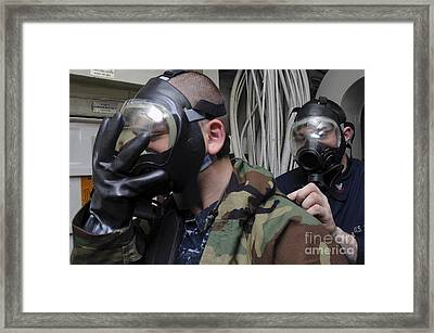 Machinist's Mate Helps Another Sailor Framed Print by Stocktrek Images