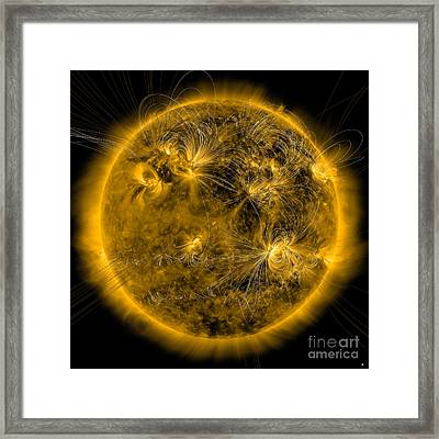 Magnetic Field Lines On The Sun Framed Print by Stocktrek Images