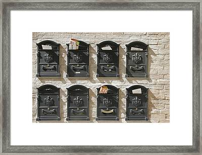 Mailboxes Lined On A Stone Wall Framed Print by Gina Martin